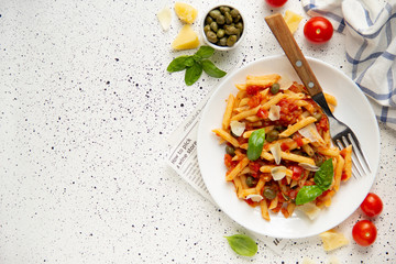 Traditional pasta putanesca with tomato sauce (capers, onions, garlic, anchovies). Tasty Italian food with Parmesan cheese, vegetarian Penne Fototapete