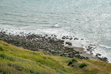 view of the coastline with stones