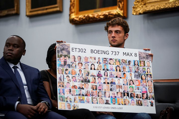 Adnaan Stumo, who lost his sister Samya Rose Stumo in the Ethiopian Airlines Flight 302 crash hold a poster during a House Appropriations subcommittee hearing on aviation certifications, on Capitol Hill in Washington