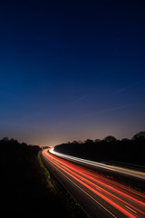 Traffic light trails highway at night
