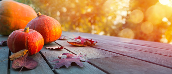 Foto op Plexiglas Herfst Autumn pumpkin on wooden table; thanksgiving holiday party background,
