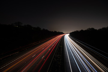 Fotobehang Nacht snelweg Traffic light trails highway at night