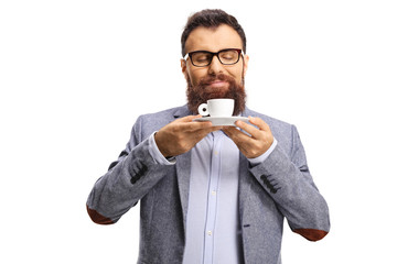 Bearded man smelling a cup of espresso coffee