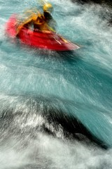A man moves through the rapids on the Metolius River, Oregon.