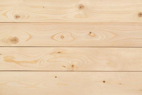Freshly-planed wood planks closeup