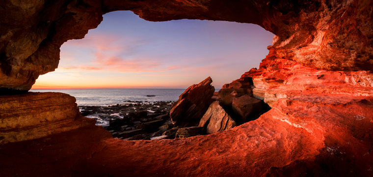 Looking out from a small cave at  Gantheaume Point  Broome  Western Australia at sunset