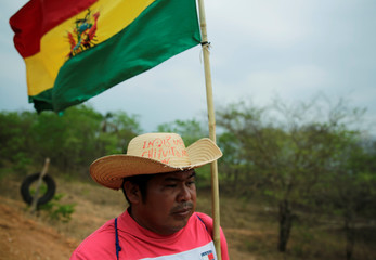 """A man with a hat that reads """" Chiquitano indigenous"""" marches from San Ignacio to Santa Cruz de la Sierra during the 10th Indigenous March to defend Mother Earth near San Rafael"""