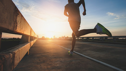 Athlete runner feet running on road, Jogging at outdoors. Man running for exercise.Sports and...