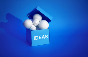 Ideas inspiration concepts with group of lightbulb in blue box on color background space.Business creativity.