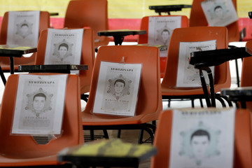"""Chairs with pictures of the missing students from Ayotzinapa Teachers Training College """"Raul Isidro Burgos"""" are seen at the college in Tixtla"""