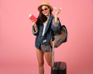 woman backpacker traveler with passport & money. journey trip travel. studio shot