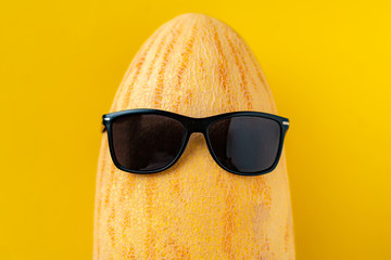 fruit mix made in the shape of the head wearing sunglasses on a melon. summer holidays concept
