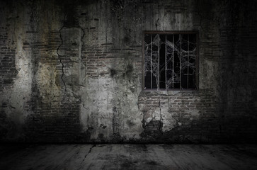 Foto op Canvas Wand Window and rusty bars covered with cob web or spider web on prison old bricks wall and dusty floor, concept of horror and Halloween