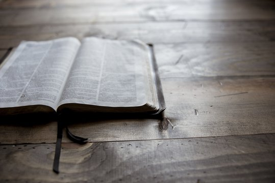 Close shot of holy bible on a wooden table