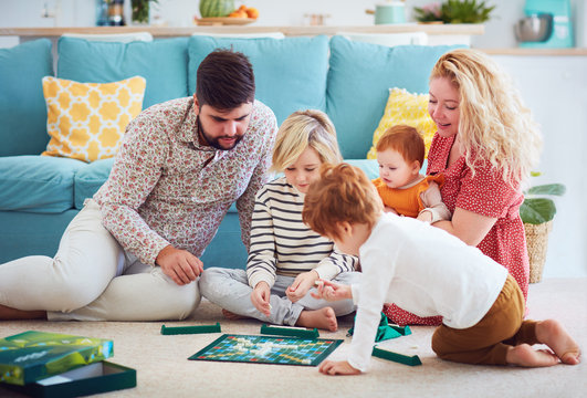 happy family playing board games together at home