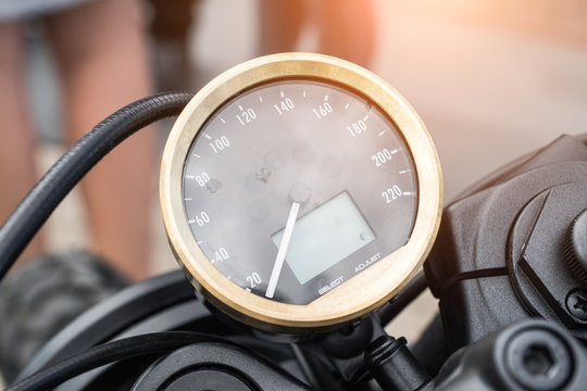 Black motorcycle speedometer with chrome ring