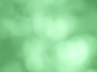 Defocused vibrant green plants leaves bokeh background. Mint green color of 2020