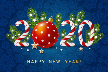 New Year concept - 2020 candy numbers with Christmas decor on blue snowflakes background for winter holidays design