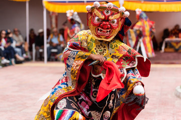 Monk performing a ritual dance in Takthok monastery, Ladakh