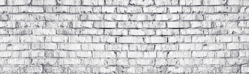 Whitewashed brick wall panoramic texture. White old brickwork masonry long panorama. Widescreen light grey background