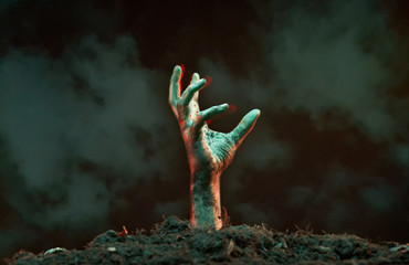 Image of zombie hand sticking out of grave. Fototapete