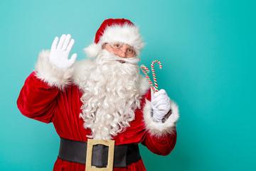 Santa Claus singing karaoke with candy cane mike
