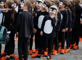 Children dressed as penguins attend ship naming ceremony in Birkenhead