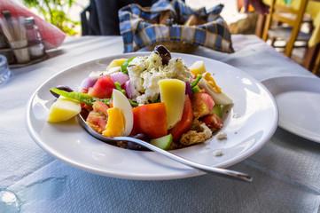 Greek salad on Crete island with egges and potato. Crete island, Greece
