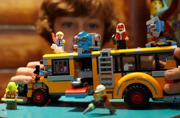 Winston Bartlett, 9, poses for a photograph with a Lego Hidden Side, Paranormal Bus 3000 after the store announced their top-ten Christmas toys, in London