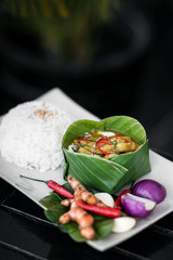 tradtional cambodian amok fish curry meal on restaurant table