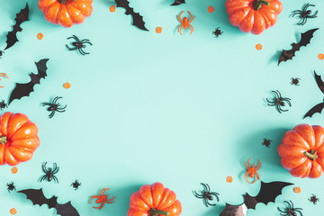 Halloween decorations on blue background. Halloween concept. Flat lay, top view, copy space Wall mural