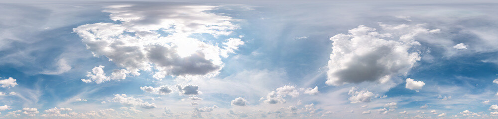 Seamless cloudy blue sky hdri panorama 360 degrees angle view with zenith and beautiful clouds for use in 3d graphics as sky dome