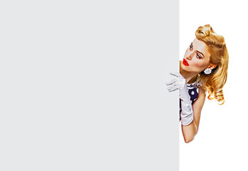 Portrait of beautiful blond girl in pin up style, showing blank signboard with copy space area for some text, slogan or advertising, isolated over white