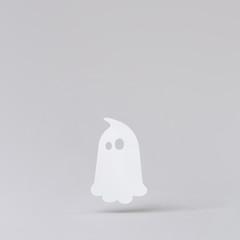 Halloween white ghost. Minimal holiday celebration funny concept. Bright autumn season background.
