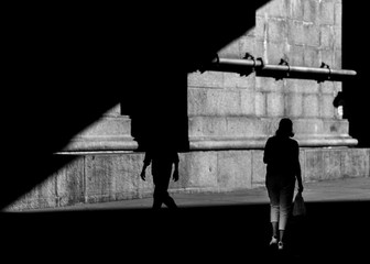 Two people in shadow on the street of Chinatown Manhattan in Black and white photo