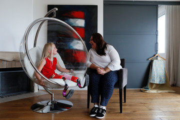 Designer Eni Hegedus-Buiron and model Daisy-May Demetre, 9 year-old double amputee who will walk the runway during Paris Fashion Week, pose for a photograph a day before the luxury children's wear label Lulu et Gigi show in Paris