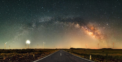 The Milky Way Arch above road. Long exposure, night landscape with Milky Way Galaxy. Amazing astrophotography. Universe, astronomy and astrophotography. Mountains of Madeira Island, Portugal.