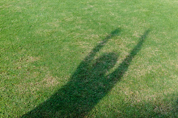 The shadow of player trow the soccer football on the artificial grass soccer field.