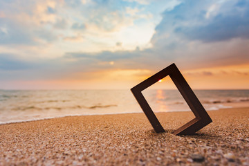 Picture frames placed on sandy beaches during the time Sunset concept idea background nature style abstract