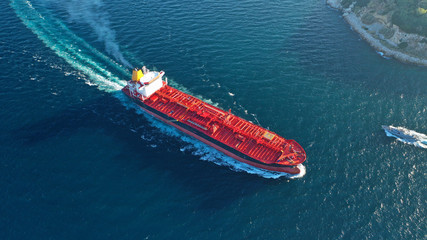 Aerial top down photo of industrial oil and fuel tanker cruising open ocean sea