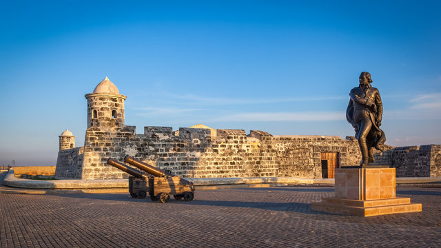 The old colonial castle of San Salvador de la Punta (or Castillo de San Salvador de la Punta) and the statue of the Venezuelan revolutionary Francisco de Miranda, Havana, Cuba