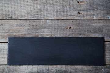 Black Friday, Shopping and sale concept. Background, copy space. Black plate on wooden background
