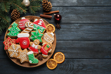 Fotobehang - Flat lay composition with tasty homemade Christmas cookies on dark blue wooden table, space for text