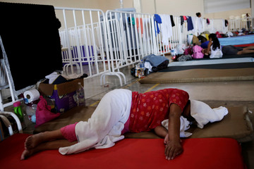 Migrants who returned to Mexico from the U.S. under the Migrant Protection Protocols, rest at a migrant shelter run by the federal government in Ciudad Juarez