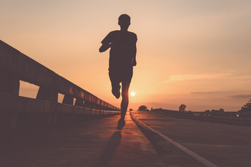 Athlete runner feet running on road, Jogging at outdoors. Man running for exercise.Sports and healthy lifestyle concept.