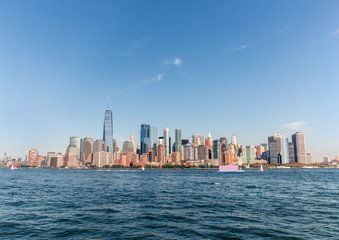 Wall Mural - New York Skyline Cityscape showing several prominent buildings and hotels under a blue sky.