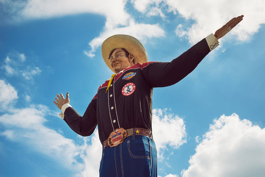 Big Tex statue at Fair Park. The figure icon greets and waves his hands to welcome visitors at the State Fair of Texas fairgrounds on October 5, 2017 in Dallas, Texas.