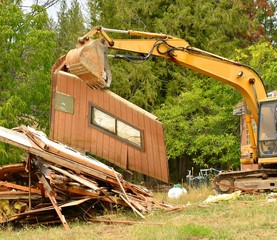 Excavator No Hope sign on wall house demolition