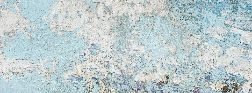 very old and dirty light blue paint texture peeling off the concrete wall for banner background
