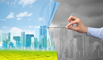 Fotomurales - hand pulling green cityscape curtain to gray cityscape, environmental protection concept